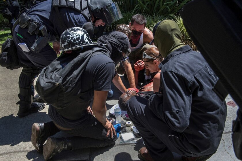 A victim is attended to after he was stabbed during a violent confrontation between members of a neo-Nazi rally and counter-protesters at the state Capitol in Sacramento last summer.