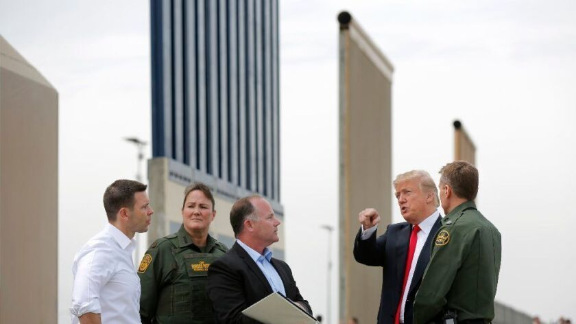 Trump visits border wall prototypes