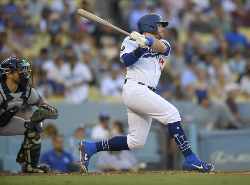 Dodgers third baseman Max Muncy hits a two-run double.