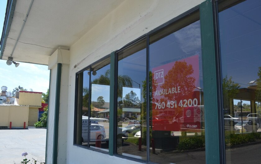 A sign notes a property in the Encinitas Village Square I complex is for lease.