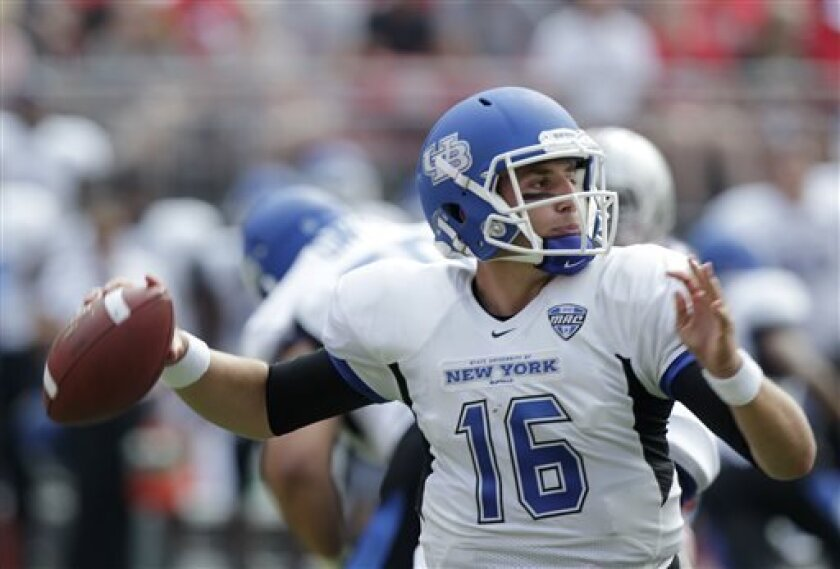 Buffalo quarterback Joe Licata drops back to pass against Ohio State during the first quarter of an NCAA college football game Saturday, Aug. 31, 2013, in Columbus, Ohio. (AP Photo/Jay LaPrete)
