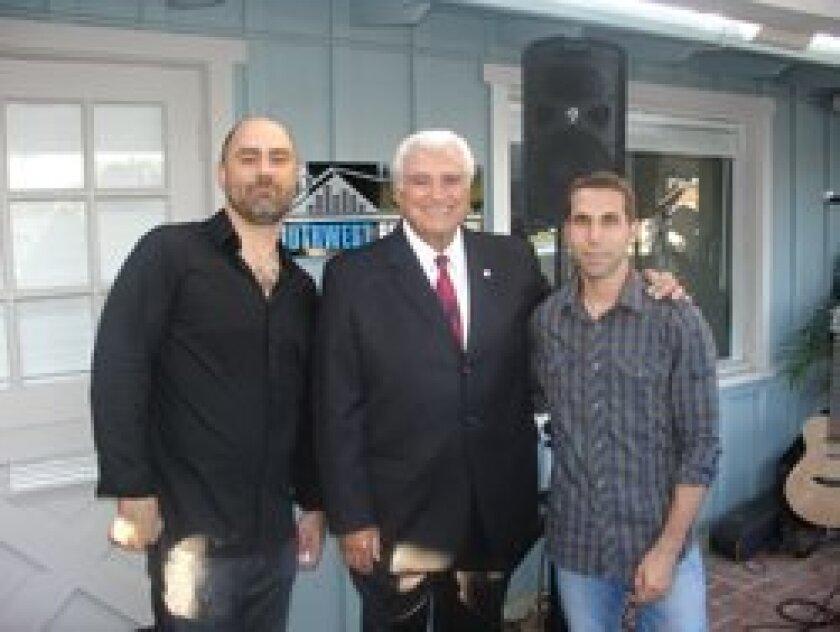 Southwest Audio Visual owners Jim Diez and Bill Kauzlarich with Solana Beach Mayor Joe Kellejian (center).