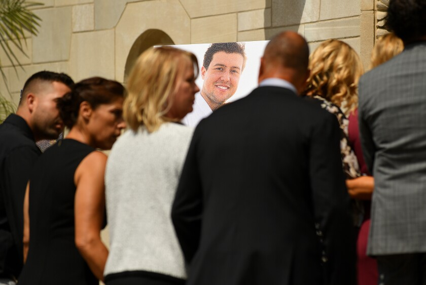 Family members of Angels pitcher Tyler Skaggs attend a memorial service on Monday.
