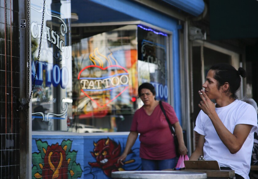 A shopper enjoys a cigarette along Sunset Boulevard in Echo Park.