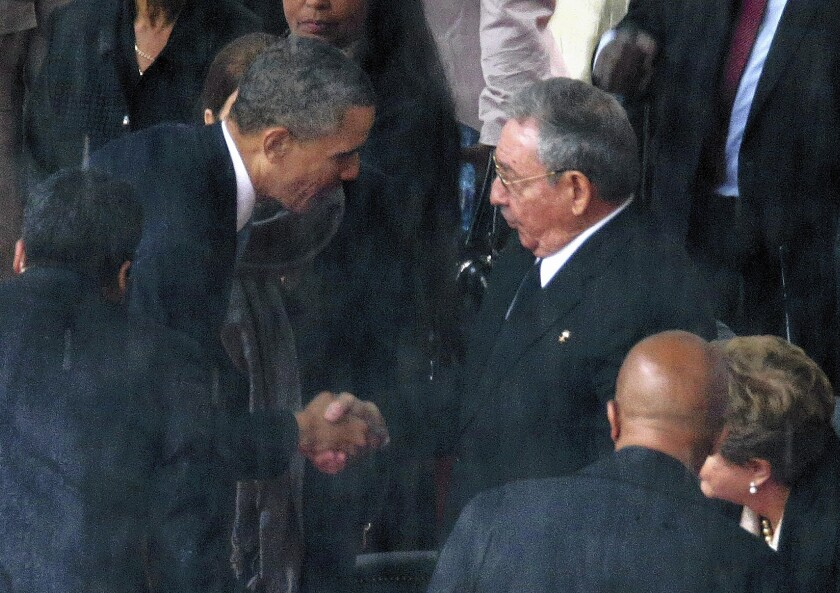 Obama handshake with Cuba's Castro stirs reaction