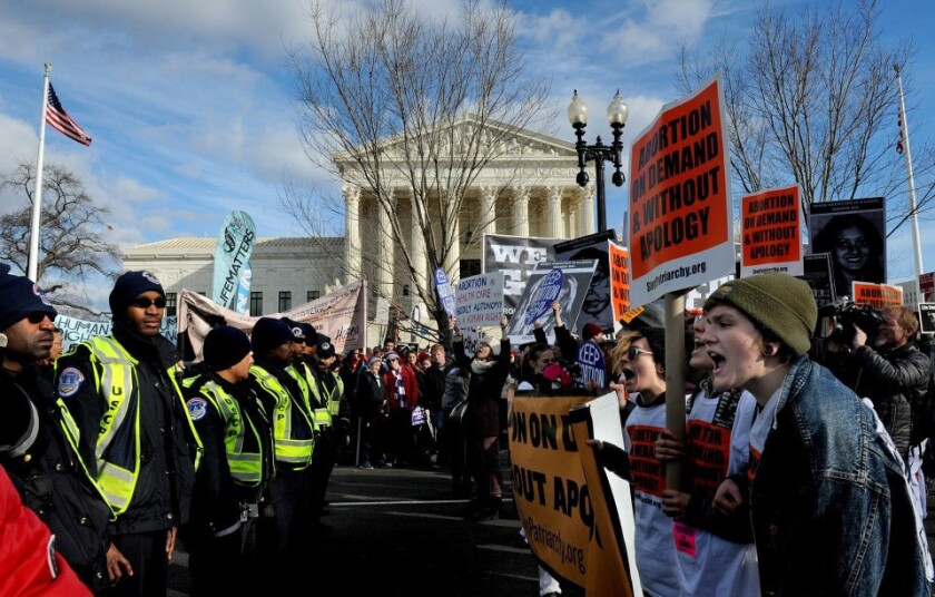 Anti- and pro-abortion-rights demonstrators outside the Supreme Court