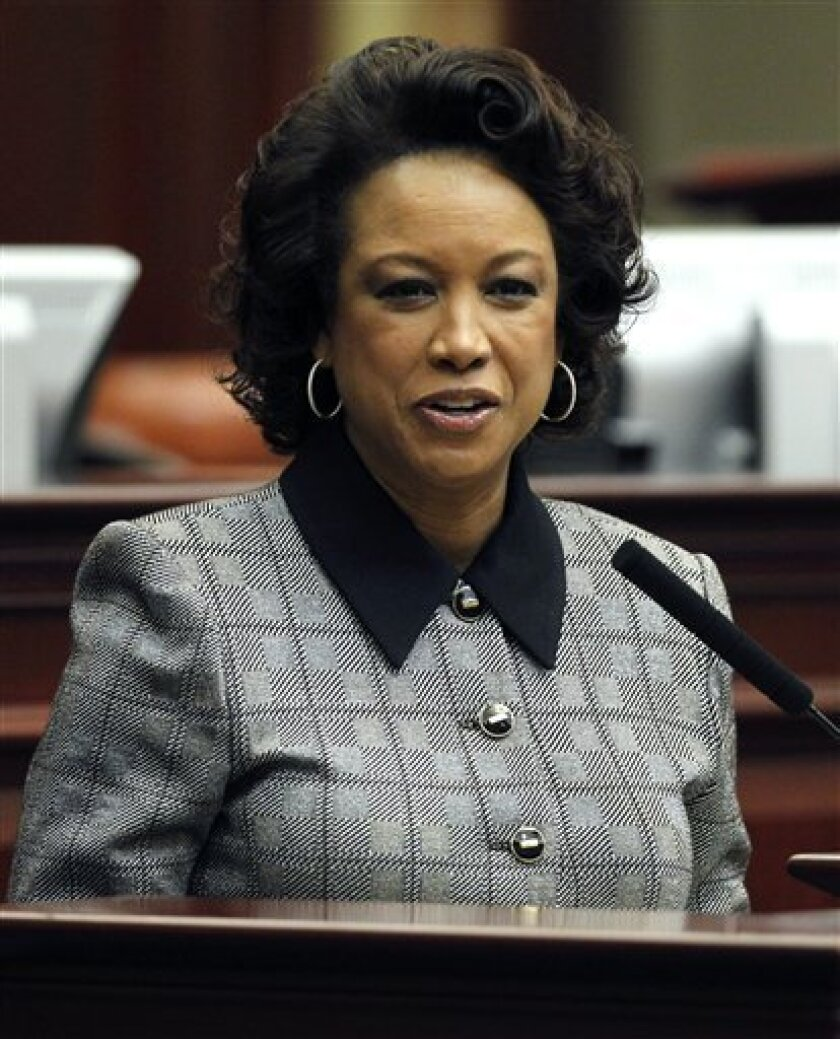 FILE - In this Jan. 11, 2012 file photo, Florida Lt. Gov. Jennifer Carroll speaks during Florida Space Center day in Tallahassee, Fla. Carroll abruptly resigned Wednesday, March 13, 2012 after authorities questioned her ties into internet cafes that authorities say are fronts for gambling. (AP Photo/Chris O'Meara, File)