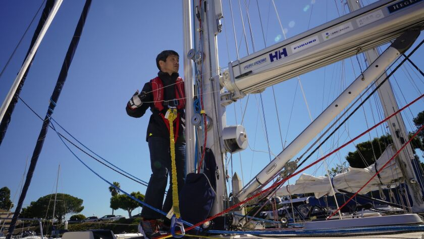 "Mitsuhiro ""Hiro"" Iwamoto prepares the main sail of the Dream Weaver before leaving on a test sail outside San Diego Bay. Iwamoto, who is blind, and Doug Smith plan to sail from San Diego to Japan nonstop this winter."
