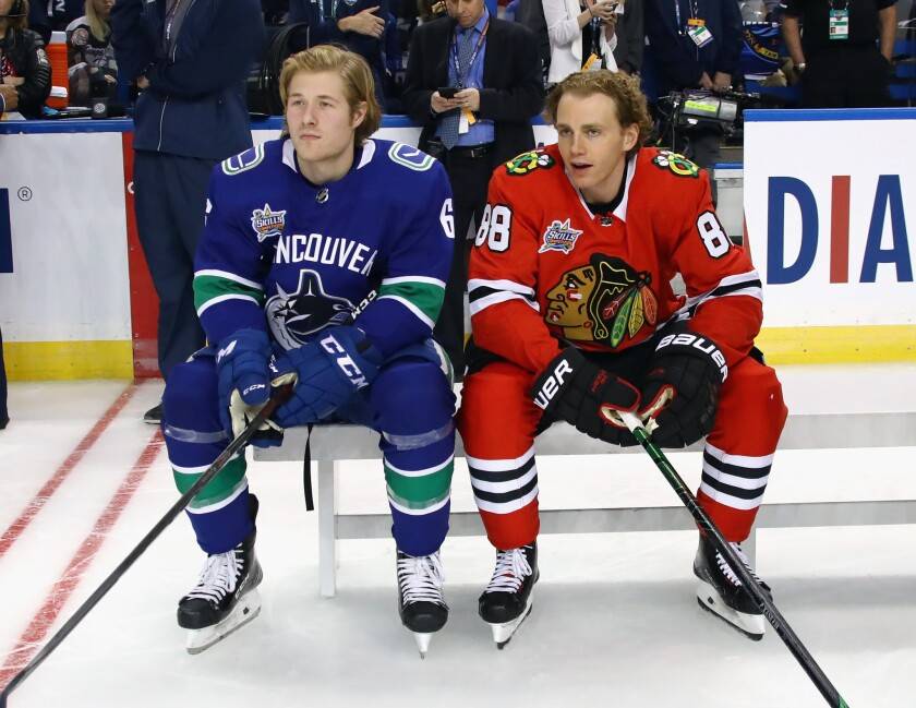 Brock Boeser, left, of Vancouver sits with Patrick Kane of Chicago during the NHL All-Star Skills Competition.
