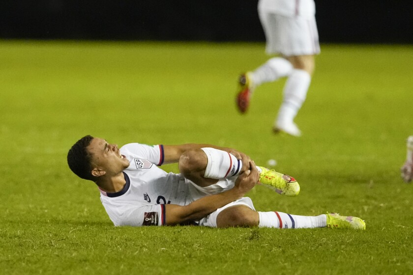 United States' Sergino Dest grimaces in pain during a qualifying soccer match against El Salvador for the FIFA World Cup Qatar 2022 at Cuscatlan stadium in San Salvador, El Salvador, Thursday, Sept. 2, 2021. (AP Photo/Moises Castillo)