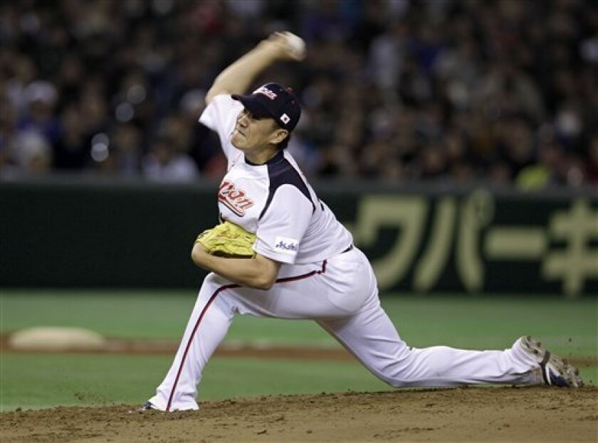 Japan's starter Masahiro Tanaka delivers a pitch against Taiwan in the second inning of their charity baseball game at Tokyo Dome in Tokyo, Saturday, March 10, 2012, on the eve of the anniversary of the March 11 earthquake and tsunami. (AP Photo/Toru Takahashi)