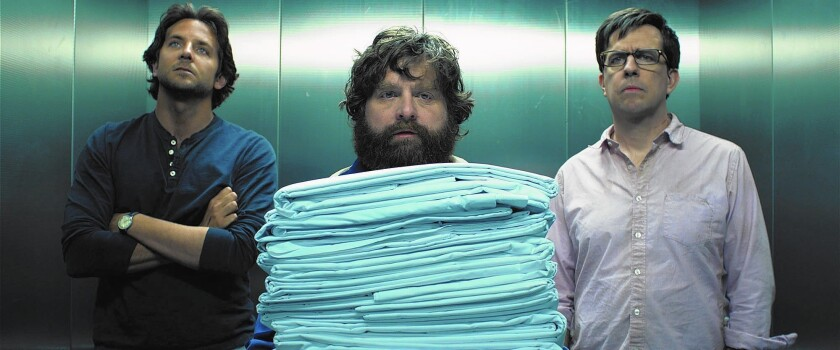 """Bradley Cooper, left, Zach Galifianakis and Ed Helms in """"The Hangover Part III."""""""