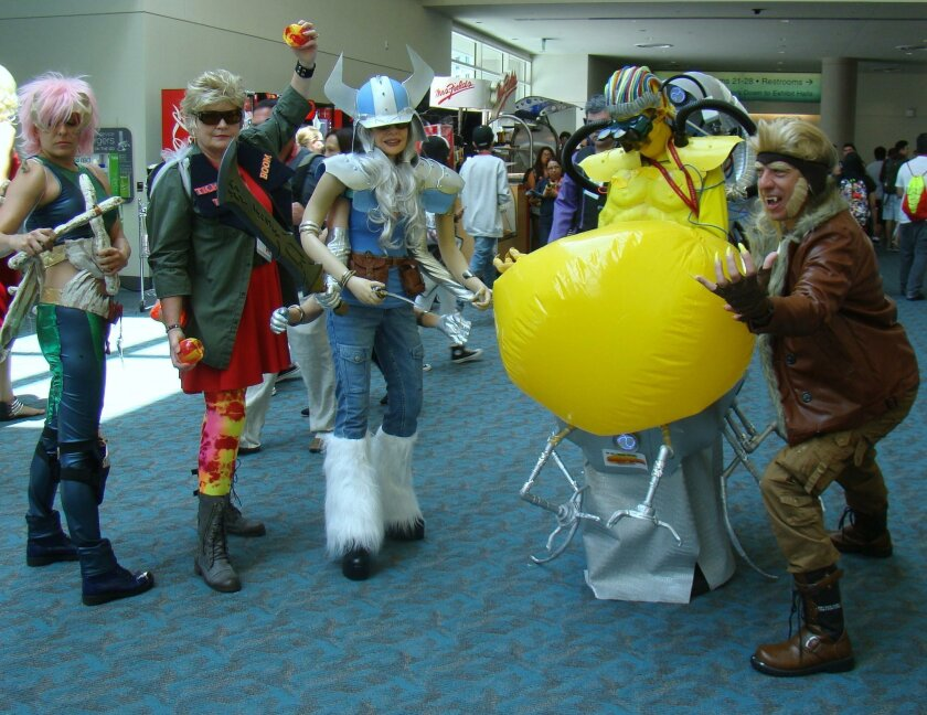 How do you navigate Comic-Con floors with six arms? Just ask Liz Ochs (center).