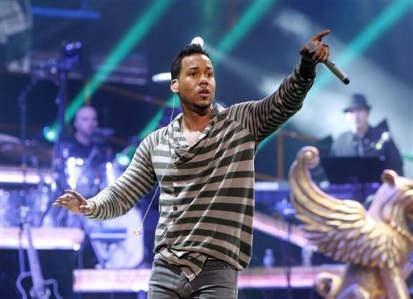 FILE - In this Feb. 24, 2012 file photo, Romeo Santos performs during a concert at Madison Square Garden in New York. For years, the main route to fame for Latin music artists in the United States was win over mainstream audiences by singing in English, or build a Latin American fan base in Spanish