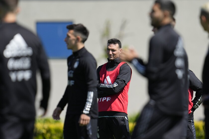 Soccer coach of Argentina's national team, Lionel Scaloni, leads his players in a training session ahead of a FIFA World Cup Qatar 2022 qualifier match against Paraguay, in Buenos Aires, Argentina, Wednesday, Oct. 6, 2021. (AP Photo/ Natacha Pisarenko)