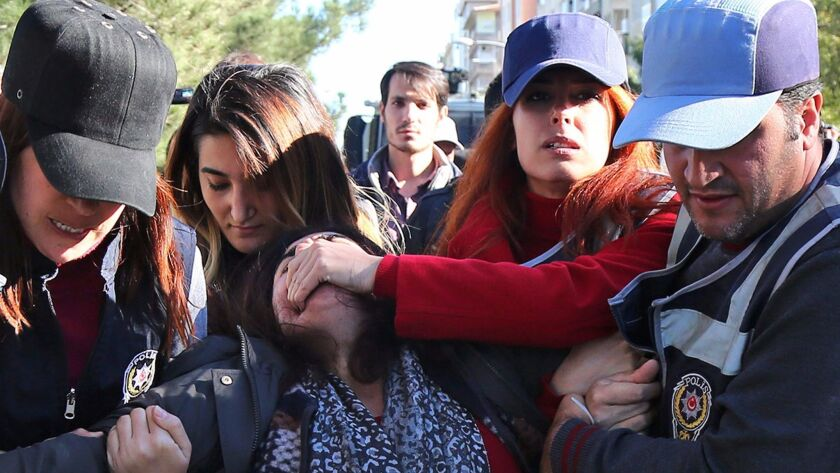 Plainclothes Turkish police arrest Kurdish member of parliament Sebahat Tuncel during an anti-government protest Friday in Diyarbakir.