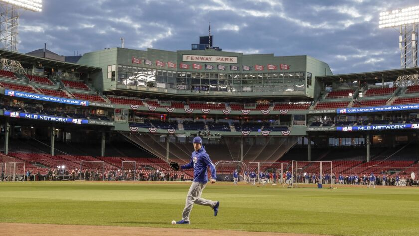 Dodgers outfielder Cody Bellinger practices fielding a ball coming off the center-field wall a day before Game 1 of the 2018 World Series at Fenway Park.