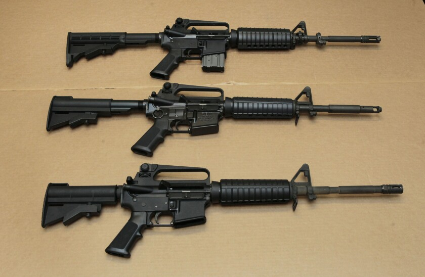 In this Aug. 15, 2012, file photo, three variations of the AR-15 assault rifle are displayed.