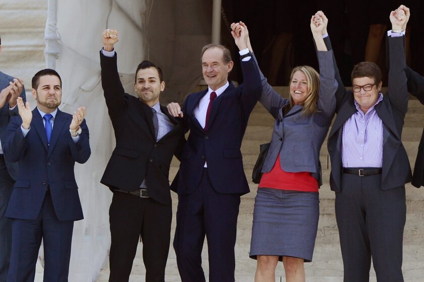 The plaintiffs' team in Hollingsworth vs. Perry, the California Proposition 8 case, celebrate after the U.S. Supreme Court's ruling was handed down. From left are Jeff Zarrillo, and his partner, Paul Katami, attorney David Boies, Sandy Stier and her partner, Kris Perry.
