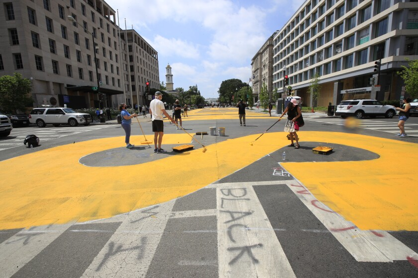 City workers and activists paint Black Lives Matter on street leading to White House