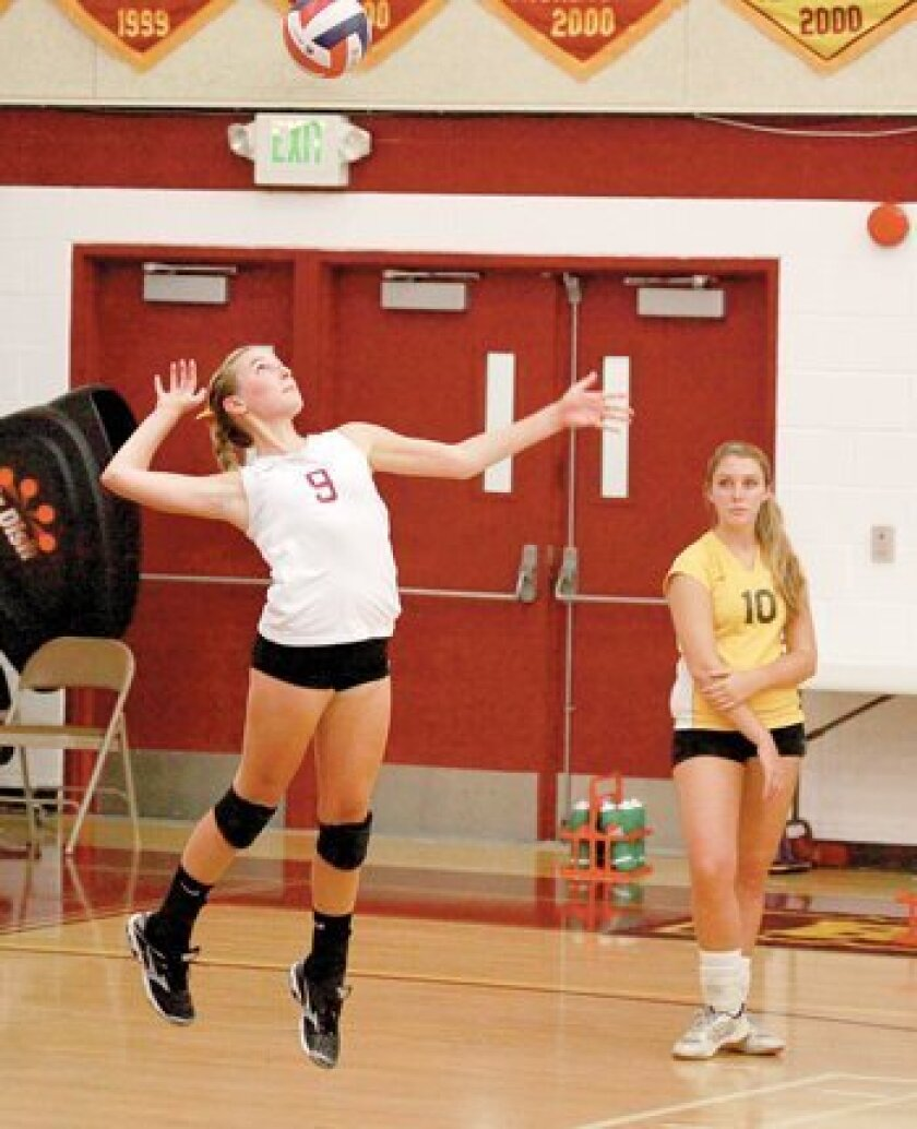 Kelly McPherson jumps up to serve the ball.
