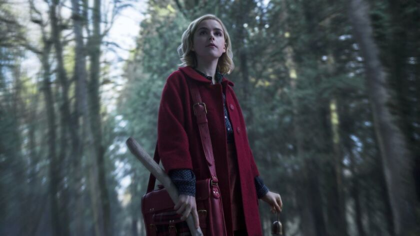 "Kiernan Shipka plays a chirpy teenage witch in a darker world in the Netflix series ""The Chilling Adventures of Sabrina."""