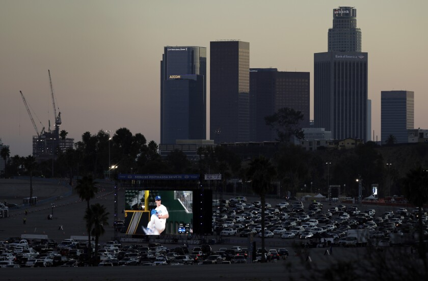 Fans drive into Dodger Stadium for a drive-in viewing party for the NLCS against the Atlanta Braves.