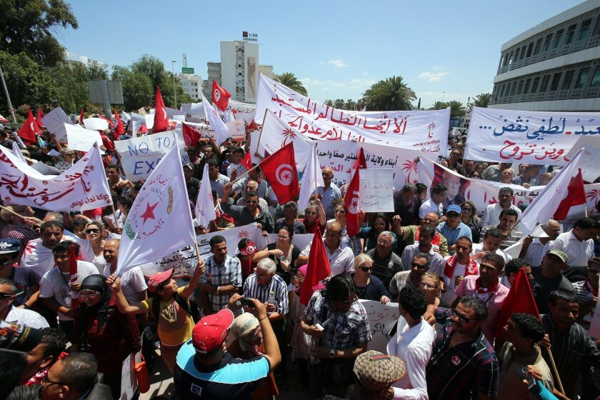 """Supporters of a new secular-based political party in Tunisia called Nidaa Tounes, or """"Call of Tunisia,"""" take part in a protest against the ruling Islamist party, Nahda. Polls show Nidaa Tounes is gaining in popularity and could win elections that most expect to occur in early 2014."""