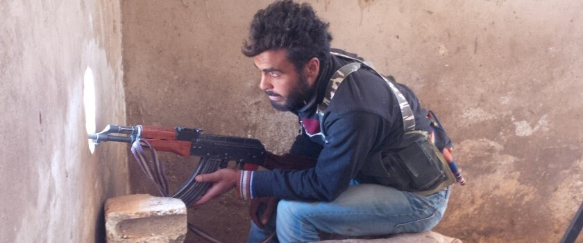 An Islamic Front rebel fighter in the northern Syrian town of Akhtarin in July.
