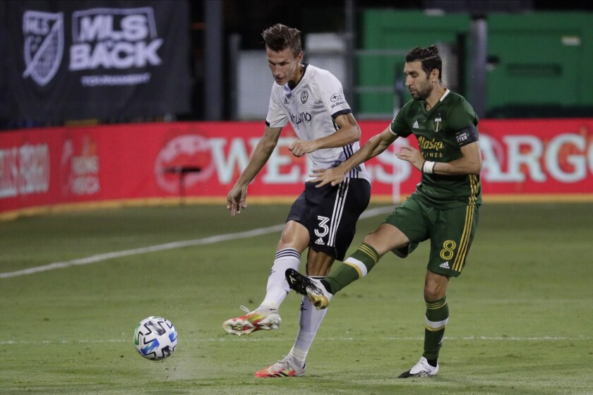 Philadelphia Union defender Jack Elliott and Portland Timbers midfielder Diego Valeri move the the ball.