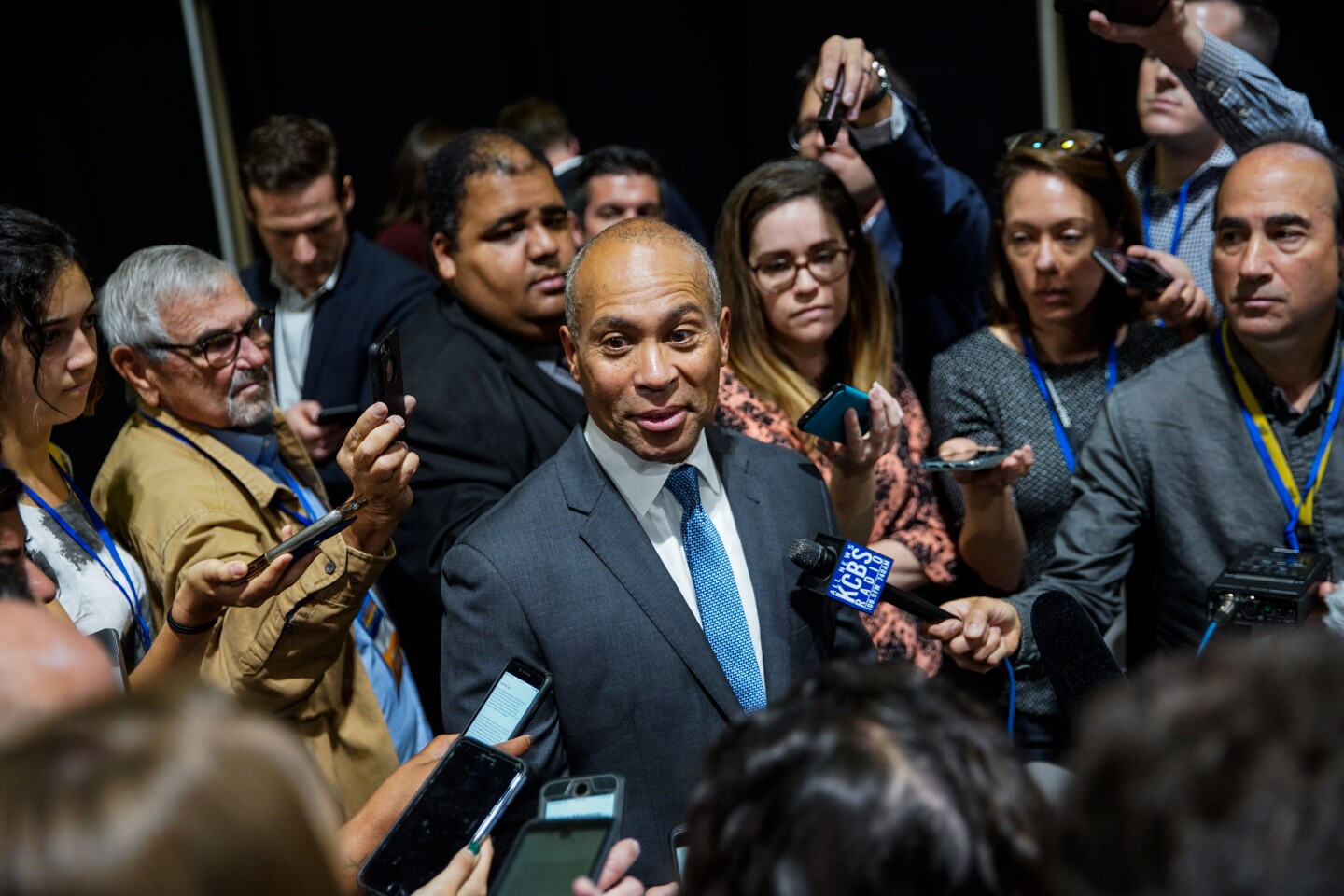 LONG BEACH, CALIF. - NOVEMBER 16: Presidential candidate and former Massachusetts governor Deval Patrick, surrounded by members of the media, speaks in the spin room, during the 2019 California Democratic Party Fall Endorsing Convention at the Long Beach Convention Center on Saturday, Nov. 16, 2019 in Long Beach, Calif. (Kent Nishimura / Los Angeles Times)