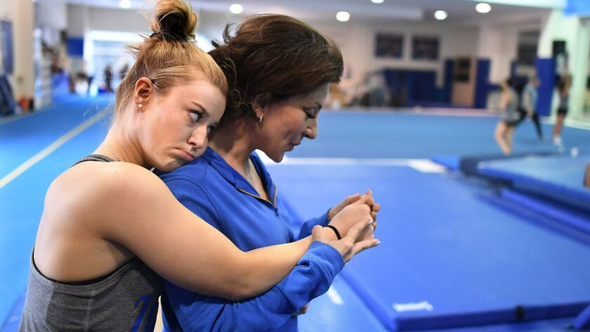 LOS ANGELES, CALIFORNIA MARCH 23, 2019-UCLA head gymnastics coach Valorie Kondos Field blows on the