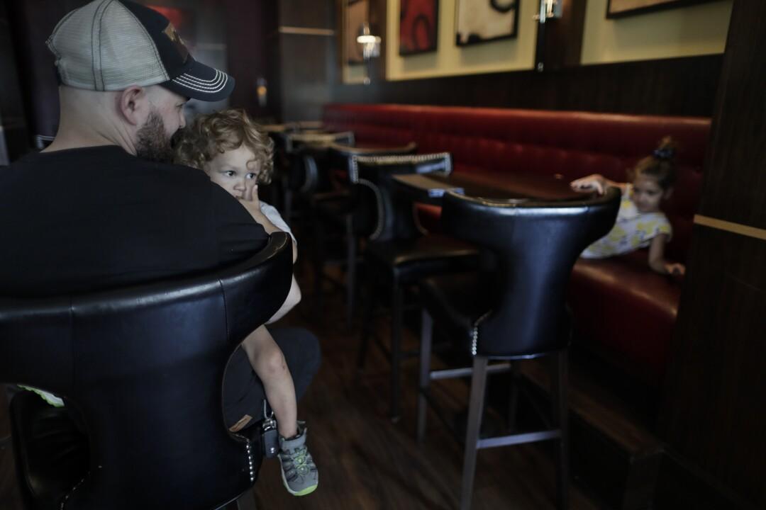 Josh Rathbun with his children Noah, left, and Charlotte at the Ambassador Hotel.