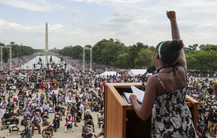 Yolanda Renee King, granddaughter of the Rev. Martin Luther King Jr., raises her fist at the March on Washington in August