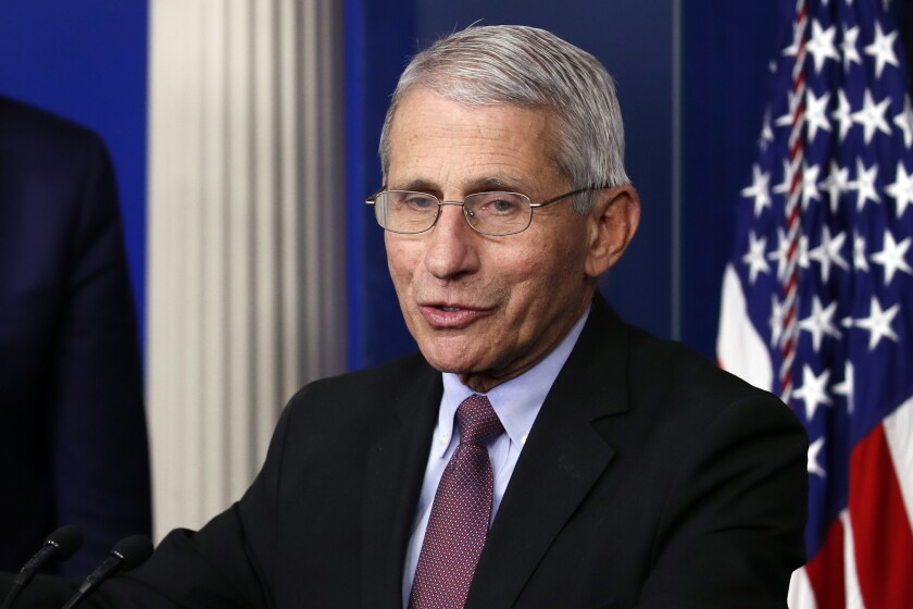 Dr. Anthony Fauci speaks about the coronavirus during a news  briefing at the White House.