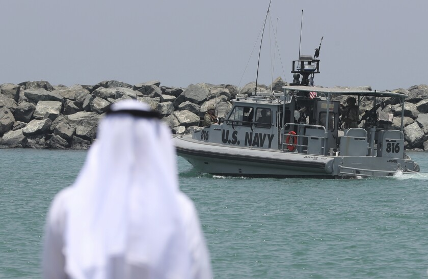 FILE- In this June 19, 2019 file photo, a U.S. Navy patrol boat carrying journalists to see damaged oil tankers leaves a U.S. Navy 5th Fleet base, near Fujairah, United Arab Emirates. The United States' Gulf allies have pushed for hawkish policies by Washington to pressure, isolate and cripple Iran, but this high-stakes strategy is now being put to the test by the surprise U.S. killing of Iran's most powerful military commander. As the region braces for what comes next, Saudi Arabia and the UAE are calling for de-escalation. (AP Photo/Kamran Jebreili, File)