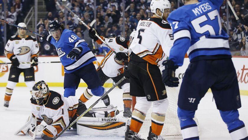 Winnipeg Jets' Tyler Myers (57) and Brendan Lemieux (48) celebrate Myers' goal against Anaheim Ducks
