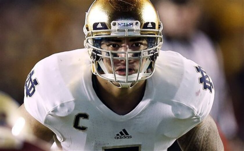FILE - In this Nov. 10, 2012, file photo, Notre Dame linebacker Manti Te'o waits for the snap during the second half of their NCAA college football game against Boston College in Boston. A story that Te'o's girlfriend had died of leukemia _ a loss he said inspired him to help lead the Irish to the