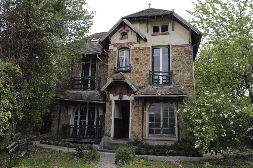 """The 120 sq. meters (1,300 sq. feet) stone house where the Nobel-winning scientist couple Marie Sklodowska-Curie and Pierre Curie spent vacation and weekends from 1904-1906 in Saint-Remy-les-Chevreuse, on the south-west outskirts of Paris, France, Wednesday, May 12, 2021. Poland's prime minister Mateusz Morawiecki says he's given instructions for the government to buy 790,000 euro house in France, and said on Twitter Tuesday that the house, is a """"part of Poland's history."""" (AP Photo/Francois Mori)"""