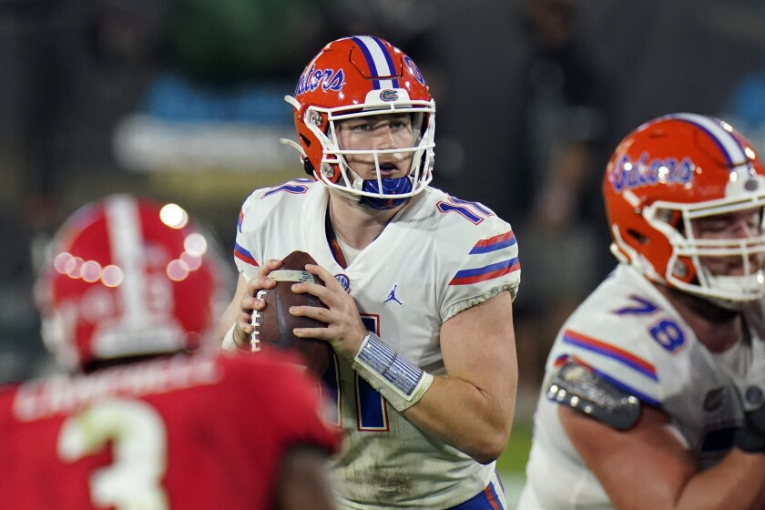Florida quarterback Kyle Trask (11) looks for a receiver during the second half of the team's NCAA college football game against Georgia, Saturday, Nov. 7, 2020, in Jacksonville, Fla. (AP Photo/John Raoux)