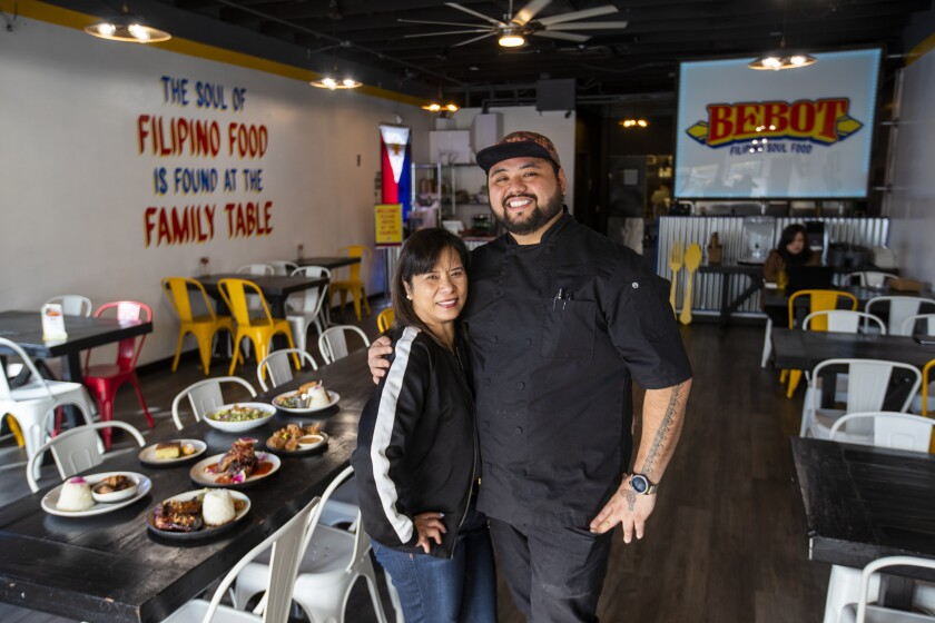 AC Boral, executive chef/owner, and his mom, Rose Boral, at Bebot Filipino Soul Food in Long Beach.