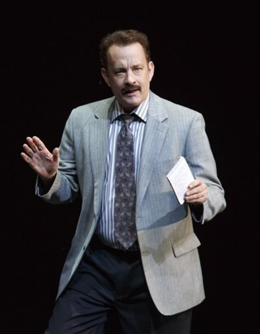 """This theater image released by Boneau/Bryan-Brown shows Tom Hanks as tabloid columnist Mike McAlary during a performance of """"Lucky Guy,"""" playing at the  Broadhurst Theatre in New York.  (AP Photo/Boneau/Bryan-Brown, Joan Marcus)"""