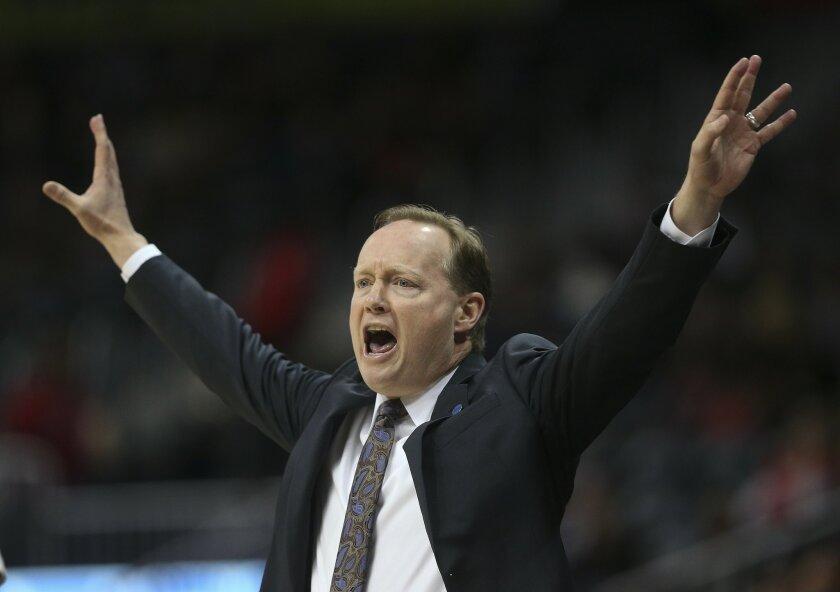 Atlanta Hawks head coach Mike Budenholzer reacts in the first half of an NBA basketball game against the Orlando Magic  Monday, Feb. 8, 2016, in Atlanta. (AP Photo/John Bazemore)