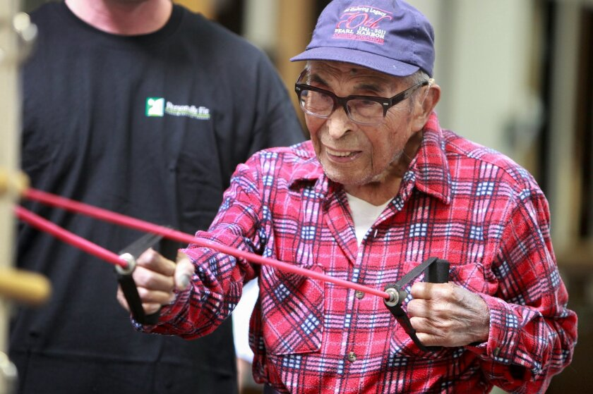 Pearl Harbor survivor Ray Chavez, 103, does his bi-weekly workout at Personally Fit gym in Rancho Bernardo Tuesday. In six months Chaves put on 20 pounds of muscle and cut his body fat from 33 to 7 percent, according to his trainer Sean Thompson.