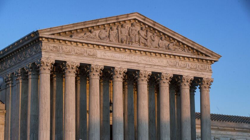 The U.S. Supreme Court building at sunset Wednesday in Washington.