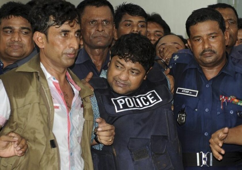 Sohel Rana, center, the owner of a building that collapsed, killing more than 1,100 people, is brought to court in Dhaka, Bangladesh.