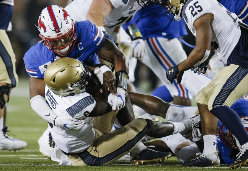 SMU linebacker Delano Robinson (3) sacks Navy quarterback Dalen Morris (8) during the second half of an NCAA college football game, Saturday, Oct. 31, 2020, in Dallas. (AP Photo/Brandon Wade)