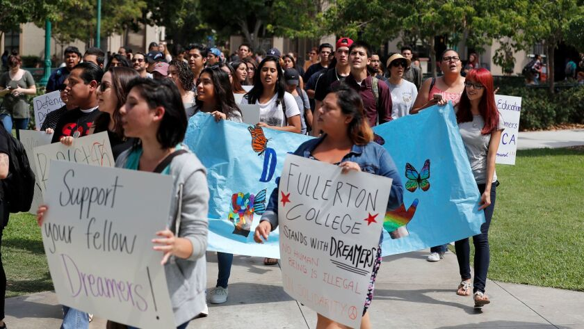 Students hold a rally of solidarity with Deferred Action for Childhood Arrivals students Sept. 14 at Fullerton College.