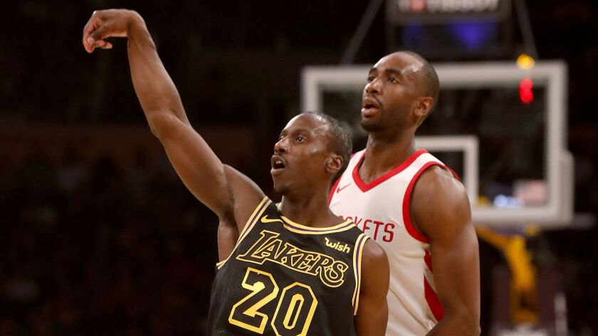 Lakers guard Andre Ingram follows through on a three-point shot against the Houston Rockets on April 10.