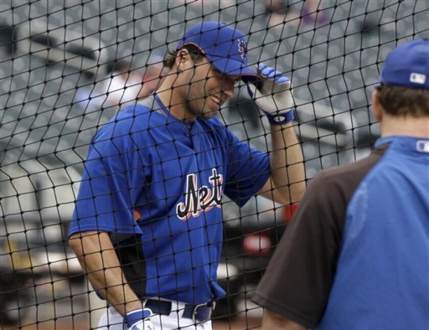 New York Mets' Jeff Francoeur talks with teammates during batting practice before a baseball game against the Cincinnati Reds, Saturday, July 11, 2009, in New York. Francouer was traded on Friday from the Atlanta Braves for Ryan Church. (AP Photo/Frank Franklin II)